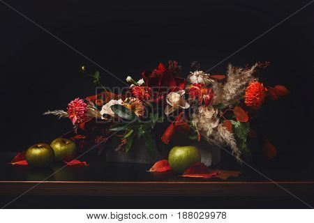 Beautiful flowers still life on black background. Flower shop composition. Florist art and floral design concept