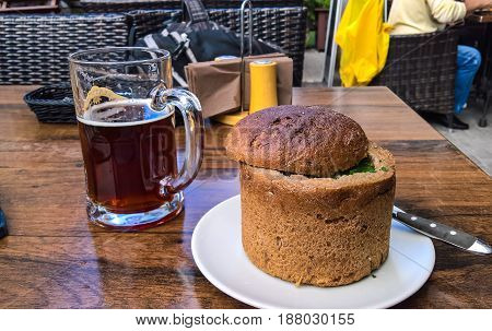 Soup in bread bowl and mug of beer at Riga Latvia