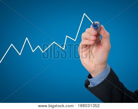Businessman Hand Drawing Graph Of Growth