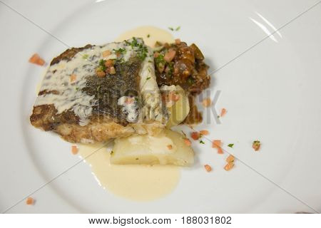 A grilled white snapper steak roasted with sauce