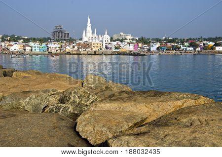 Southest India city Kanyakumari panorama from big long stones pier