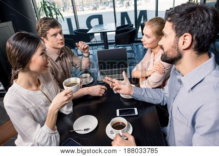 Business Team On Meeting Discussing Project With Laptop In Cafe, Business Lunch Concept