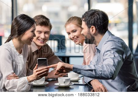 Business Team On Meeting Discussing Project With Smartphone In Cafe, Business Lunch Concept