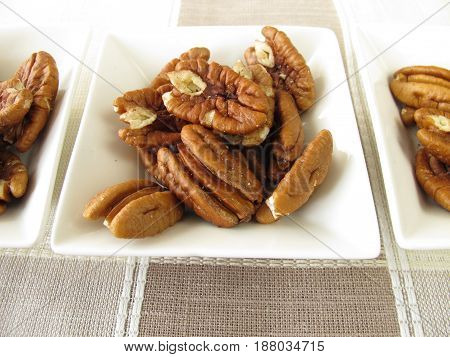Snack with pecan nuts halves in bowls