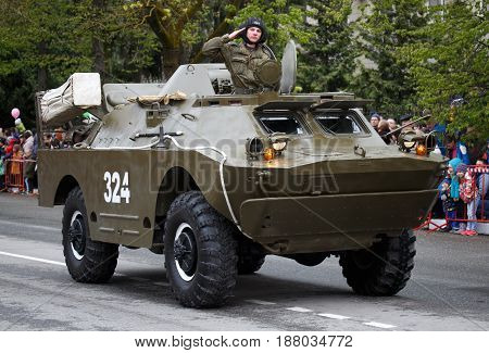 RUSSIAN KOZELSK MAY 9 2017 Victory Day May 9. Military Parade on anniversary of Victory in Great Patriotic War. Armored troop-carrier. Russian soldier on combat reconnaissance patrol vehicle.