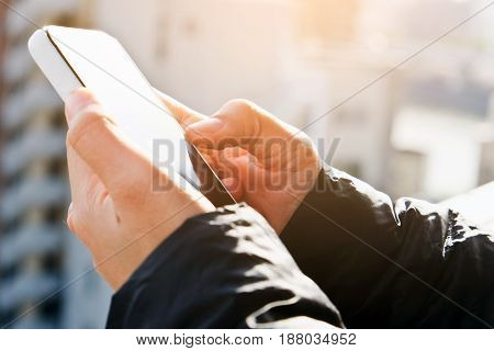 close up of hand typing on phone