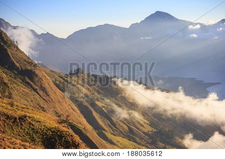 Cloudy and mist in sunset panorama view of Mountain Rinjani active volcano at Lombok island of Indonesia