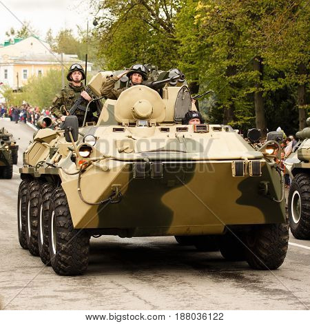 RUSSIAN KOZELSK MAY 9 2017 Victory Day May 9. Military Parade on anniversary of Victory in Great Patriotic War. Fighting vehicle. Russian armored troop-carrier with soldiers