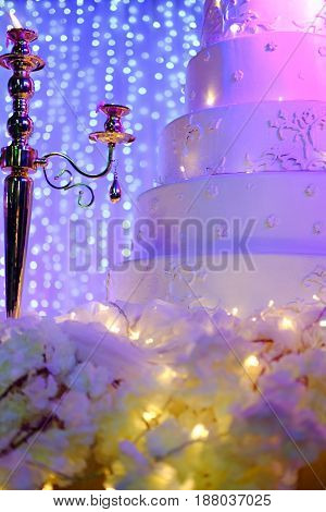 Beautiful wedding cake decorated with flowers Wedding party evening