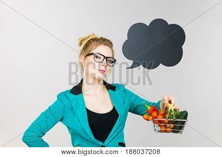 Woman Holds Shopping Cart With Vegetables, Copy Space