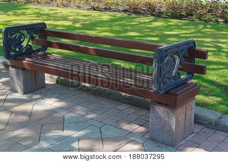 Empty bench in the alley in the park. Urban