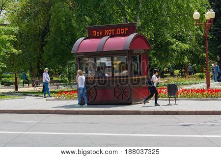 Makeevka Ukraine - May 24 2017: People at a stall selling fast food at noon