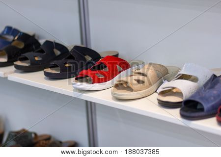 Variety of sandals on the shop counter. Shoes