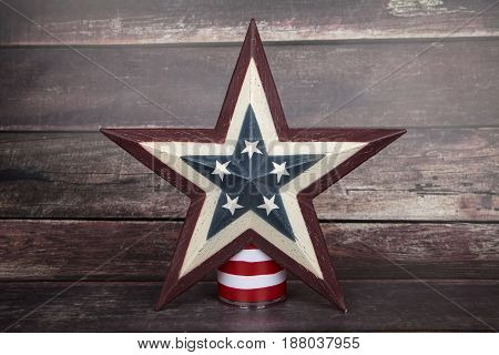 A patriotic star against a wood background