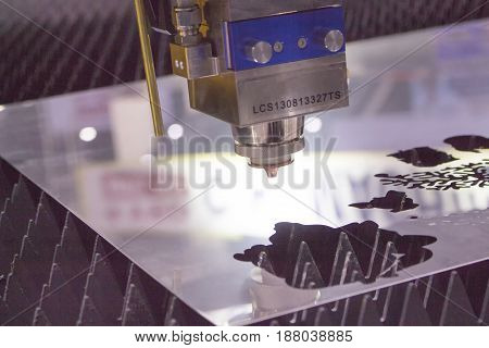 Closeup Laser cutting nozzle / CNC Industrial laser cutting steel metal