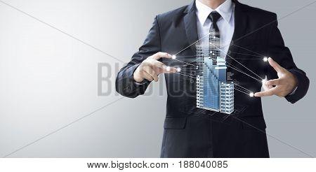 Business Man Create Design Modern Skyscrapers In 3D Render