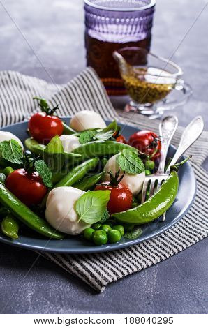 Raw vegetable salad with mozzarella and spices. Selective focus.