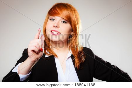 Young business woman smiling and shaking wagging her finger student girl scolding on gray