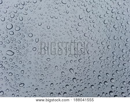 Rainy day: Water drop on the house window
