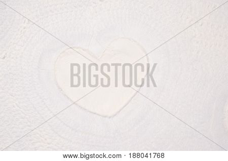 white textured paper sheet with heart shape