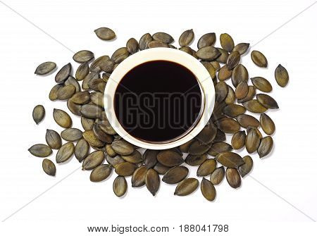 pumpkin seed oil and pumpkin seeds isolated over white background