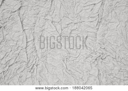 gray and crumpled paper sheet background texture