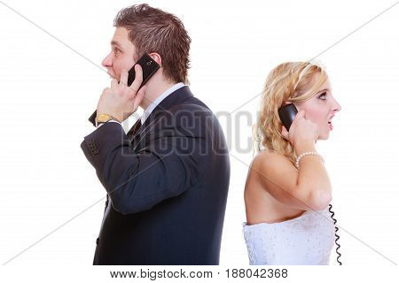 Relationship problems and troubles concept. Groom and bride calling to each other having quarrel argument.