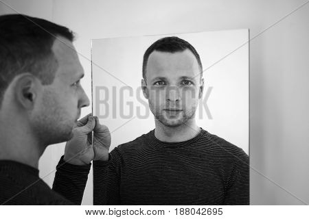 Black And White Portrait Of Young Man With Mirror