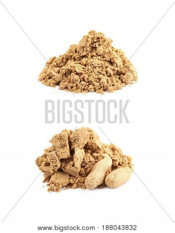 Pile of crushed and crumbled turkish halva confection next to a couple of peanuts, composition isolated over the white background, set of two different foreshortenings