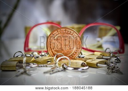 Brass Bitcoin Coin And Padlocks