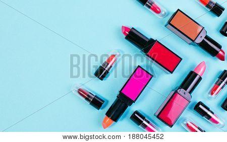 Various Of Vivid Color Lipstick Make Up On Pastel Blue Effect Vintage Background. Lipstick Backgroun