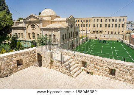 View of the Armenian Church of the Holy Archangels Deir Al Zeitoun and football field in the Armenian Quarter of Jerusalem Israel