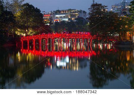 HANOI, VIETNAM - JANUARY 10, 2016: the Red bridge (Bridge of the Morning light) on the Hoan Kiem lake in the evening twilight