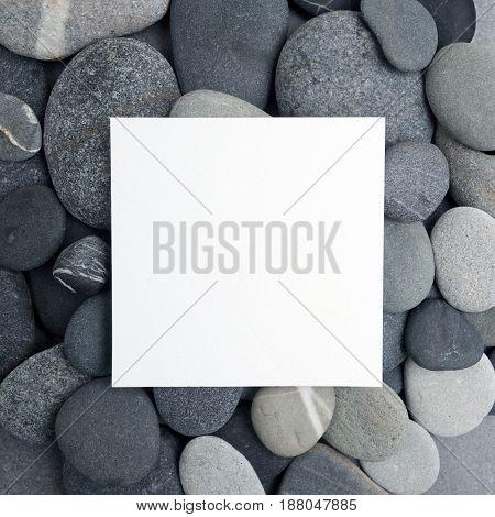 Frame of gray sea stones. Flat lay.