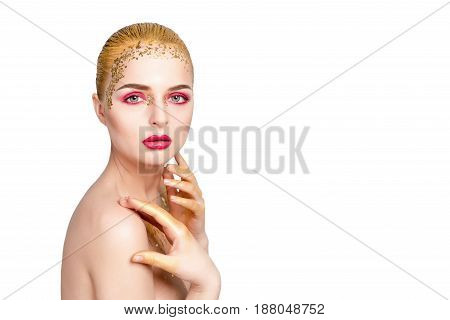 Beauty woman portrait. Beautiful model girl with perfect fresh clean skin and bright golden professional makeup. Blonde female on white background with evening pink and gold make-up, space for text.