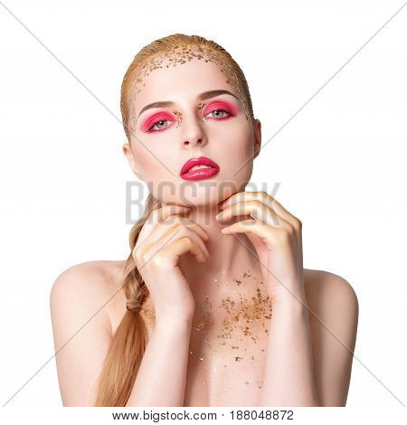 Beauty woman portrait. Beautiful model girl with perfect fresh clean skin and bright golden professional makeup. Blonde female on white background with evening pink and gold make-up.