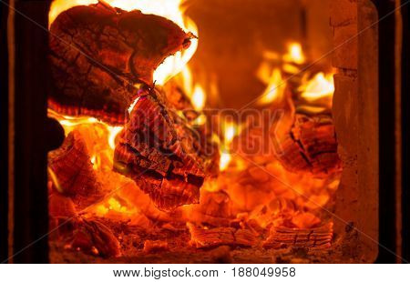 Fire and coals in brick fireplace furnace