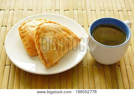curry pie stuffed chicken and bean eat couple with hot tea