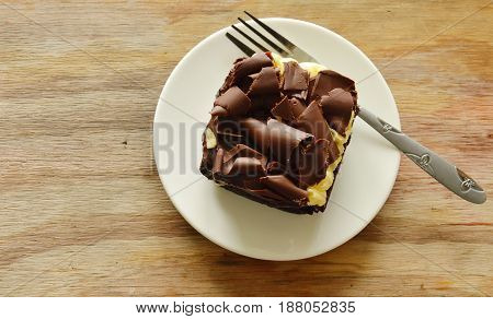 chocolate butter cake topping slicing chocolate and fork on dish