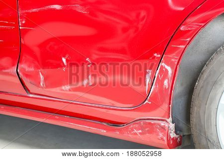 Closeup Of Hole Accident In The Side Door Of The Red Car