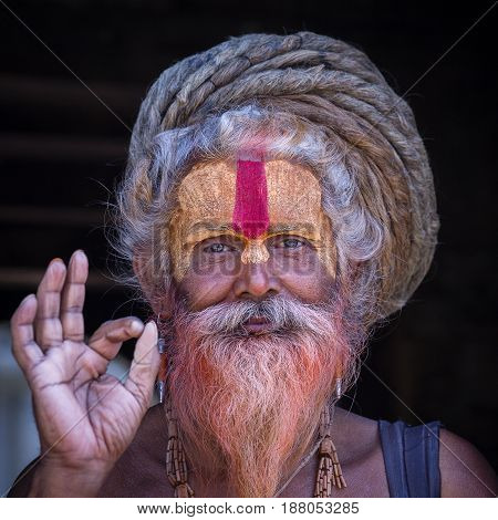 KATHMANDU NEPAL - OCTOBER 25 2016 : Portrait of Shaiva sadhu holy man in Pashupatinath Temple . Close up