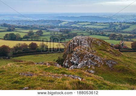 Atmospheric view of the Dartmoor National Park from the peak of Brentor. Autumn light haze. Evening. Devon. England