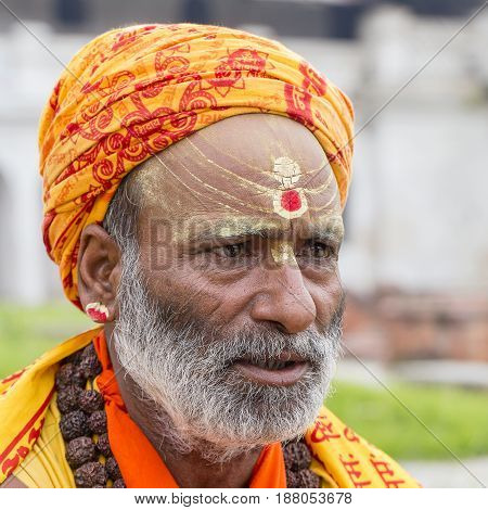 KATHMANDU NEPAL - SEPTEMBER 29 2016 : Portrait of Shaiva sadhu holy man in Pashupatinath Temple . Close up