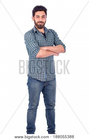 Portait of confident beard young man wearing green shirt and jeans isolated on white background