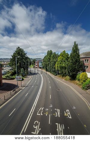 Western Way in Exeter. View from the pedestrian bridge above the road connecting the remains of the ancient Roman wall (Yaroslavl Bridge). Without cars. Devon. England