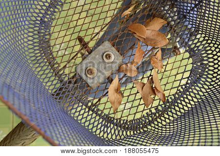 dry leaf falling in bicycle front basket in parking lot
