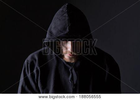 Bearded man wearing like bully on black background