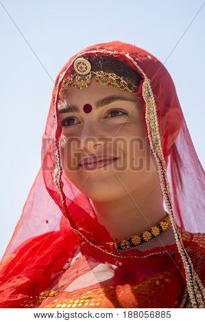 JAISALMER INDIA - FEBRUARY 09 2017 : Indian girl wearing traditional Rajasthani dress participate in Desert Festival in Jaisalmer Rajasthan India