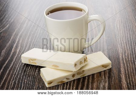 Pieces Of Nougat With Nuts And Cup With Tea