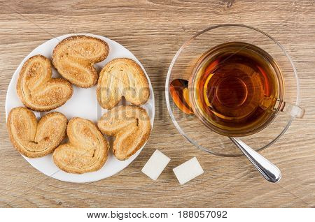 Puff Cookies In White Plate, Cup With Tea, Lumpy Sugar
